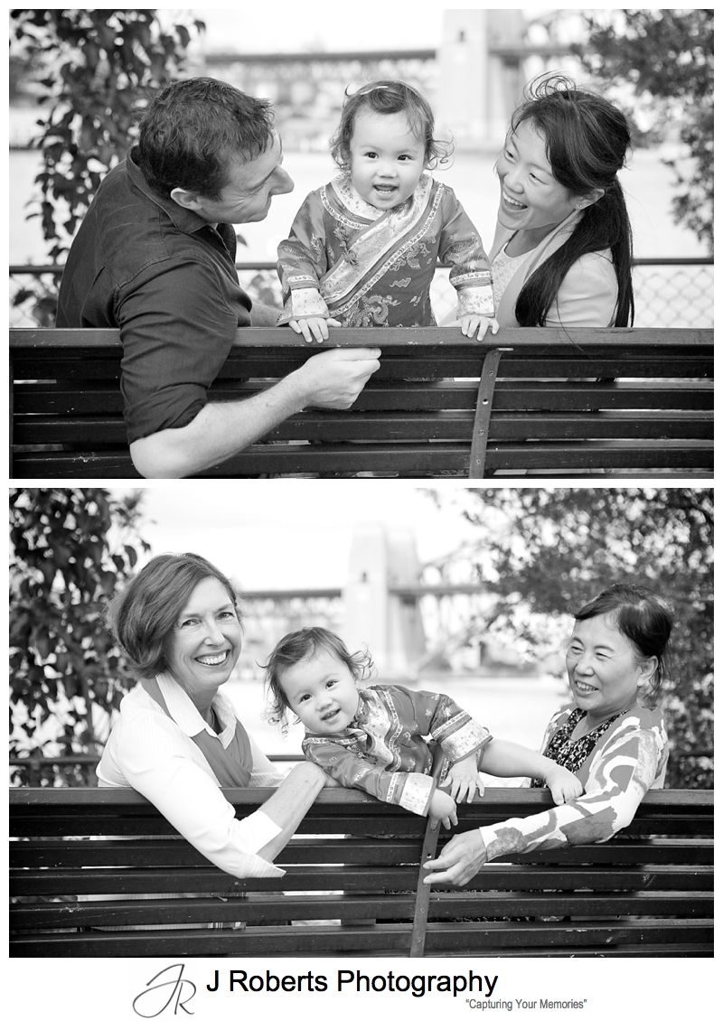 Baby girl on a bench with parents and grandmothers - sydney family portrait photography